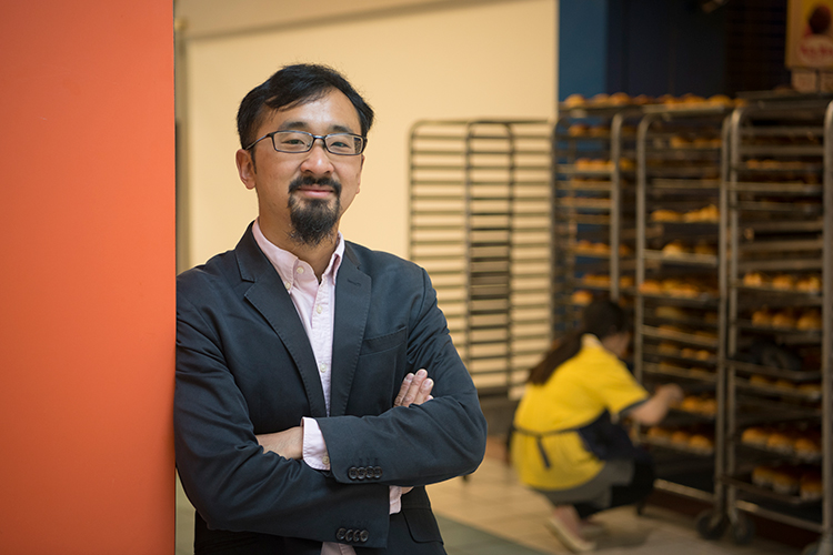 Howard Tam is a U of T alumnus and urban planner who grew up in Agincourt and also runs food tours throughout Scarborough (photo by Don Campbell)