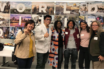 Prof Lo posing with students during World Cities Day