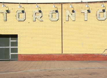 Image of a wall with Toronto written on the wall in block letters