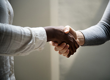 Handshake by Raw Pixel via Unsplash
