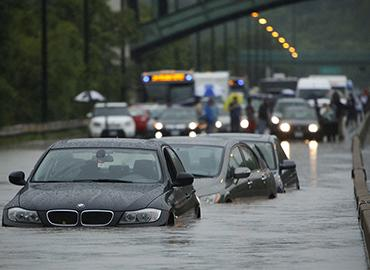 Three cars were swamped on the DVP following a rain storm in July of 2013 (photo by Randy Risling/Toronto Star via Getty Images)