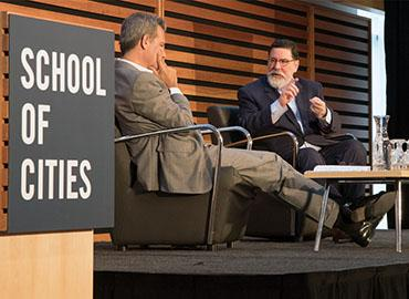 University Professor Richard Florida (left) speaks with Pittsburgh Mayor Bill Peduto about the role of cities in global conversations like climate change and the refugee crisis