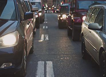 Cars in traffic photo by Nabeel Syed via Unsplash
