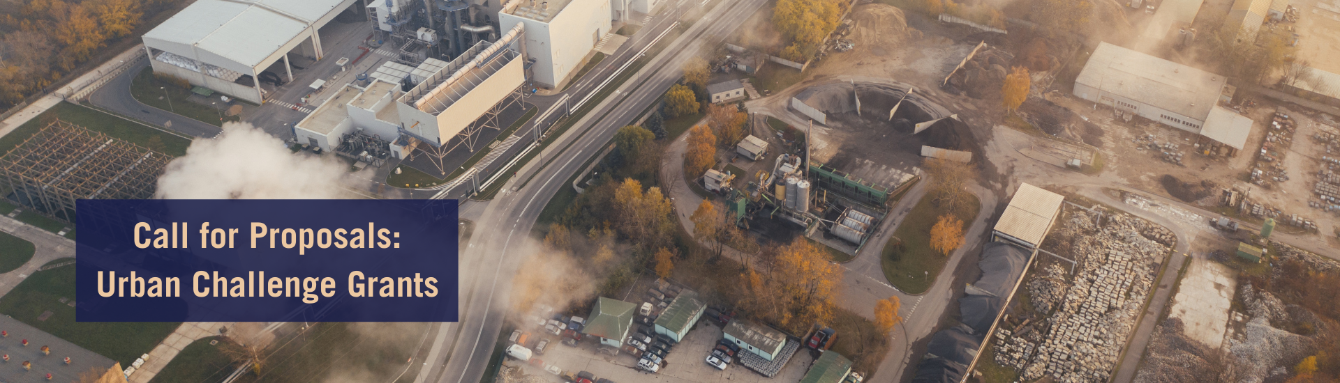 Image of an urban industrial area giving out smoke
